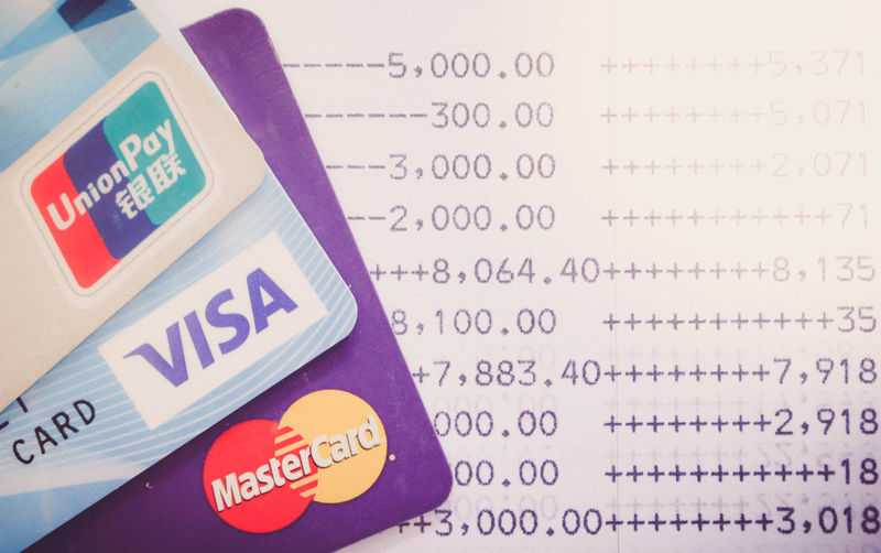 shot of credit card issued by the three brands VISA,Mastercard and UnionPay,selective focus Business Travel Bank Banking Card Close-up Communication Concept Credit Credit Card Indoors  Money No People Online  Only Women Pay Savings Still Life Text Western Script