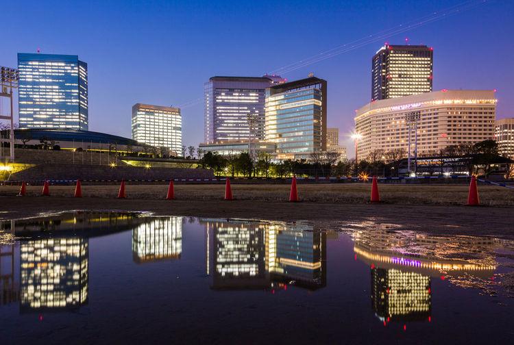 水たまりレフレクション 雨上がり大阪ビジネスパーク puddle OSAKA Japan Nightphotography After The Rain Puddle Puddleography Puddle Reflections City Cityscape Urban Skyline Neon Illuminated Modern Skyscraper Downtown District Water Office Building Exterior