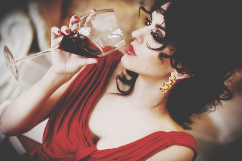 Beautiful Woman Having Red Wine In Restaurant