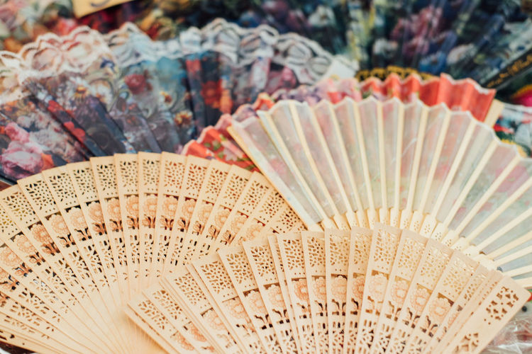 High angle view of hand fans for sale in market
