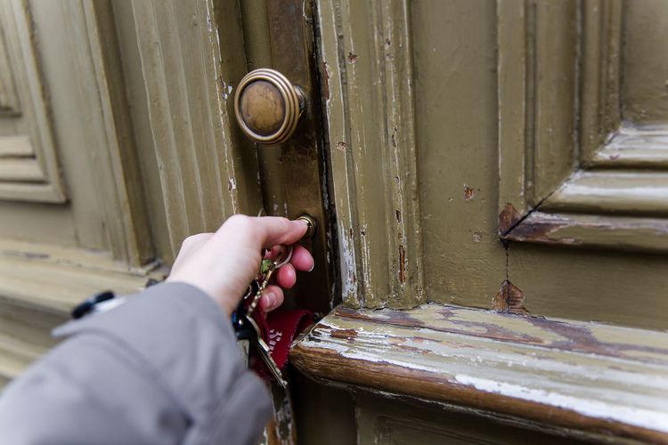 Cropped Hand Opening Door