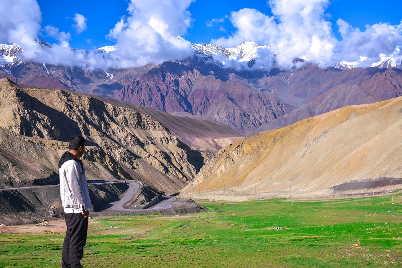 Adult Adults Only Beauty In Nature Casual Clothing Cloud - Sky Day Full Length Grass Hiking Landscape Leh Ladakh Leisure Activity Lifestyles Mountain Mountain Range Nature One Person Outdoors People Physical Geography Real People Rear View Scenics Sky Standing