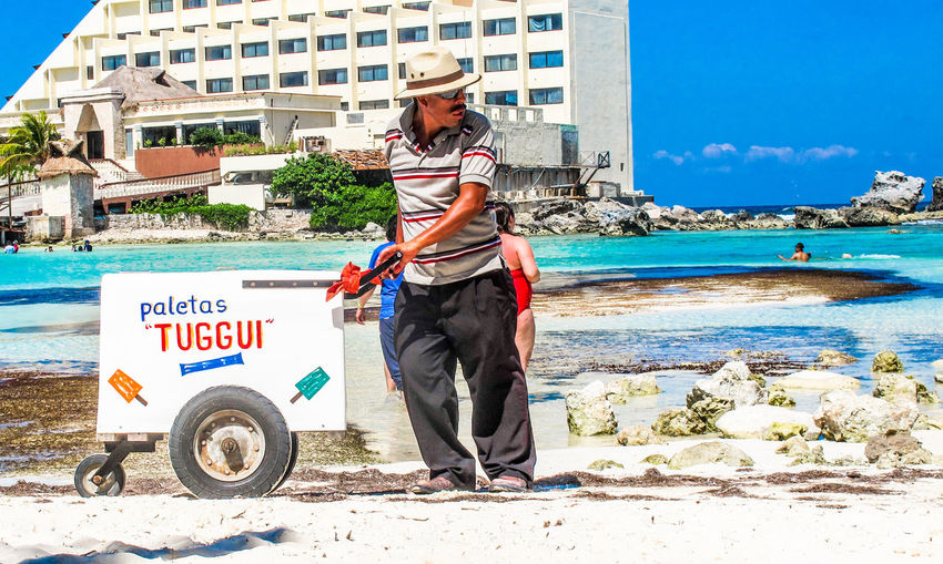 Paleta Man Adult Adults Only Architecture Communication Day Full Length Isla Mujeres Cancun Mexico Nature Occupation One Person Outdoors Paletas People Real People Sea Sky Standing Technology The Street Photographer - 2017 EyeEm Awards Tuggui Water Wireless Technology Young Adult