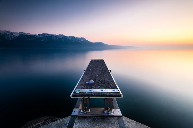 Beauty In Nature Calm Day Diving Board Empty Idyllic Jetty Jumping Board Lake Landscape Mountain Mountain Range Nature No People Non-urban Scene Outdoors Remote Scenics Sky Tranquil Scene Tranquility Water Weather First Eyeem Photo