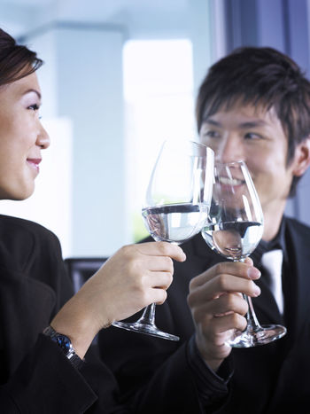 business couple work as team Celebration Alcohol Celebration Champagne Champagne Flute Close-up Couple - Relationship Drink Holding Indoors  Lifestyles Lunch Meeting Men People Real People Refreshment Togetherness Two People Waist Up Well-dressed Wine Wineglass Women Young Adult Young Women