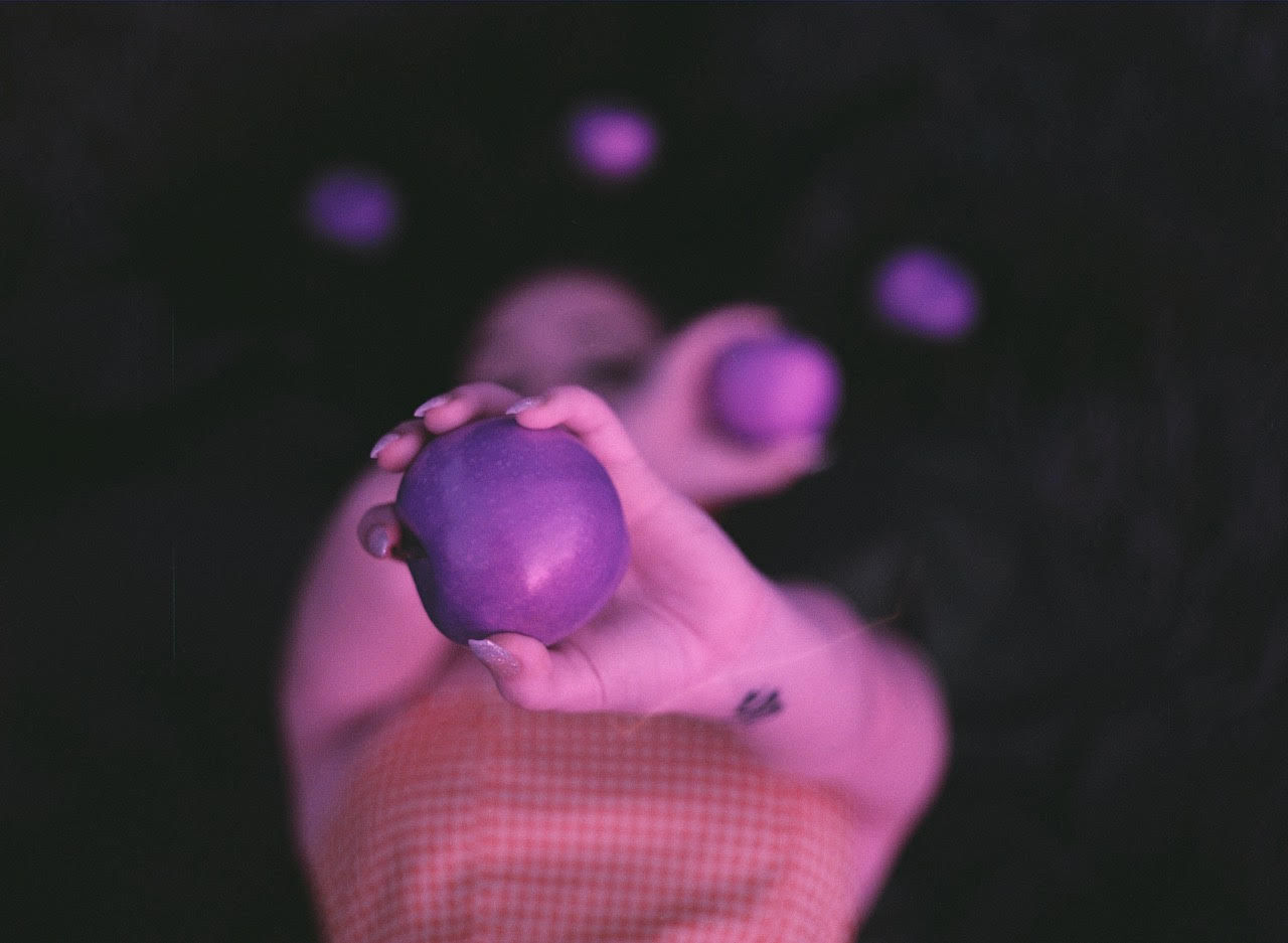 human hand, hand, holding, one person, human body part, real people, food and drink, food, freshness, lifestyles, body part, close-up, finger, focus on foreground, unrecognizable person, healthy eating, human finger, personal perspective, fruit, purple, human limb