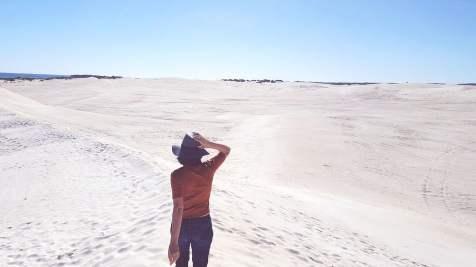 Sand Desert One Man Only Photography Themes Landscape Only Men Adult Photographing Adults Only Mid Adult One Person Photographer Mid Adult Men Sand Dune Standing Camera - Photographic Equipment Clear Sky Day Outdoors Nature