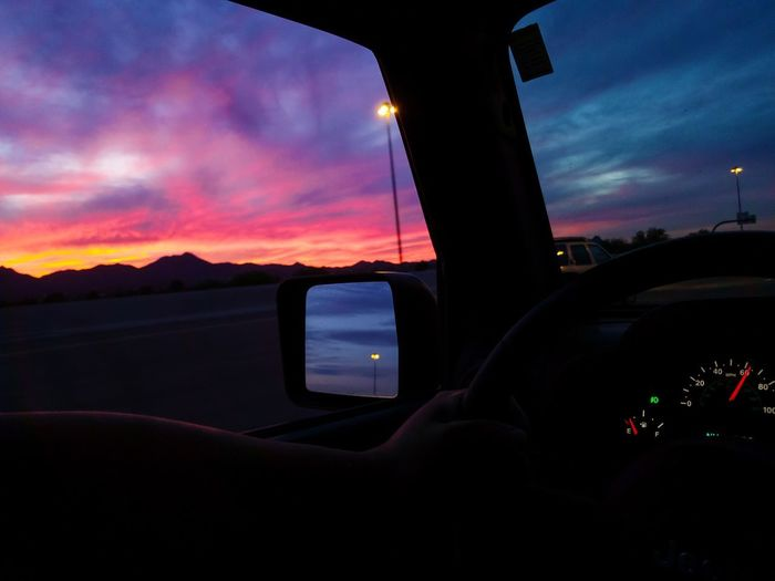 Scenic view of sky seen through car windshield