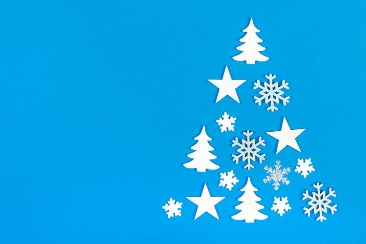 Low angle view of christmas decorations against blue background