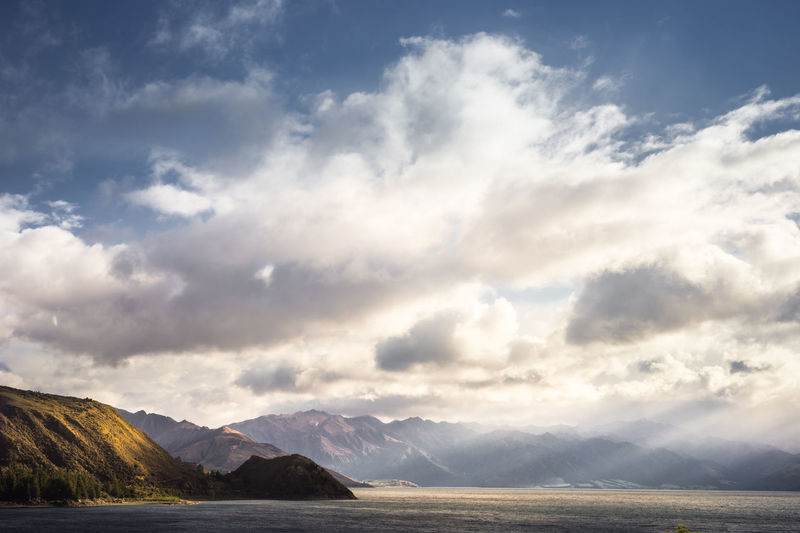 Mountain and Sky-Cloud Background Cloud - Sky Sky Mountain Scenics - Nature Beauty In Nature Water Tranquil Scene Tranquility Mountain Range Nature No People Non-urban Scene Idyllic Sea Waterfront Outdoors Landscape Remote Mountain Peak Ominous Travel Photography New Zealand Light And Shadow