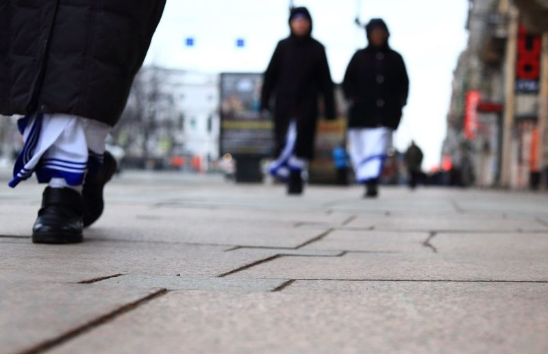 Surface level of people walking on road
