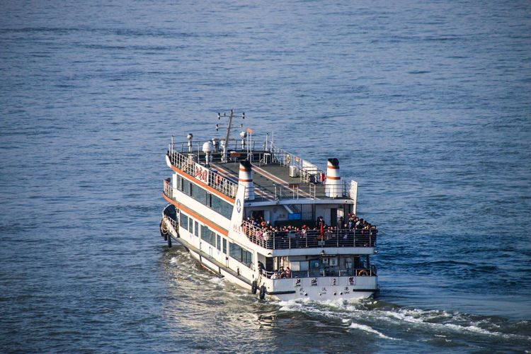 High angle view of ferry boat sailing on sea