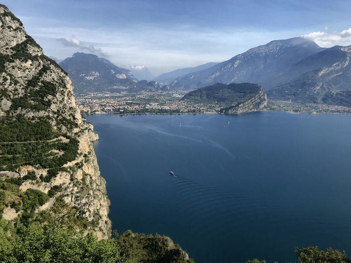 Scenic view of lake and mountains against sky lake garda