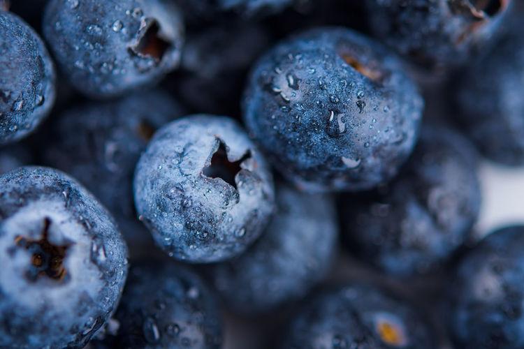 Wet fresh blueberry background. studio macro shot