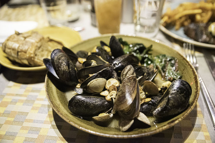 Close-up of clams in plate on table