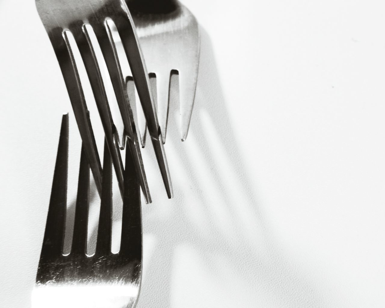 Close-Up Of Forks On White Table