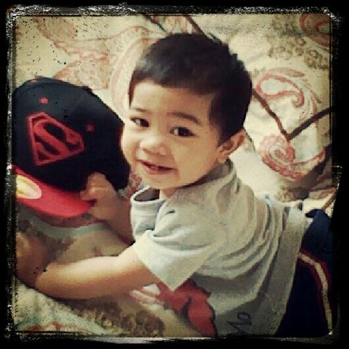 Caleb (me nephew) smiling with my superman hat xD