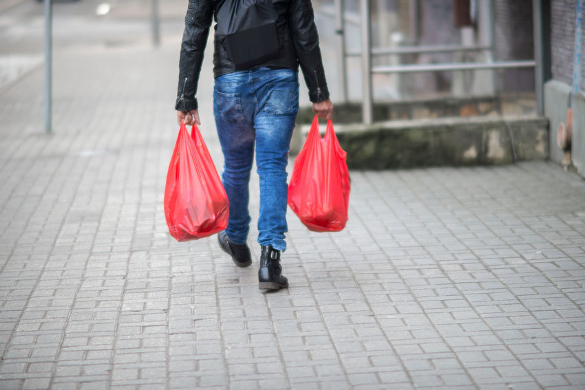 Fashion Red Shopping Winter Adult Adults Only Bag Casual Clothing Day Focus On Foreground Human Body Part Human Leg Jeans Lifestyles Low Section Motion One Person Outdoors People Purchases Real People Shopping Bags Walking Warm Clothing Women