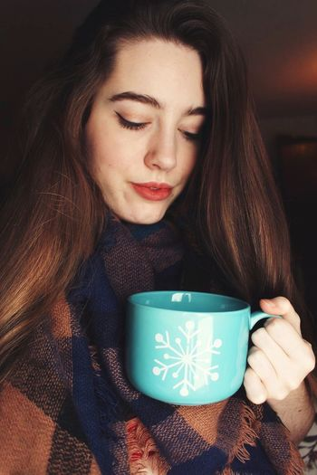 Close-Up Of Young Woman Drinking Coffee Cup