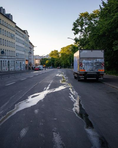 Empty street in Berlin (hermannstrasse) Parked Truck Water Stream Empty Street Transportation Road City Street Architecture Land Vehicle Mode Of Transportation Building Exterior Day