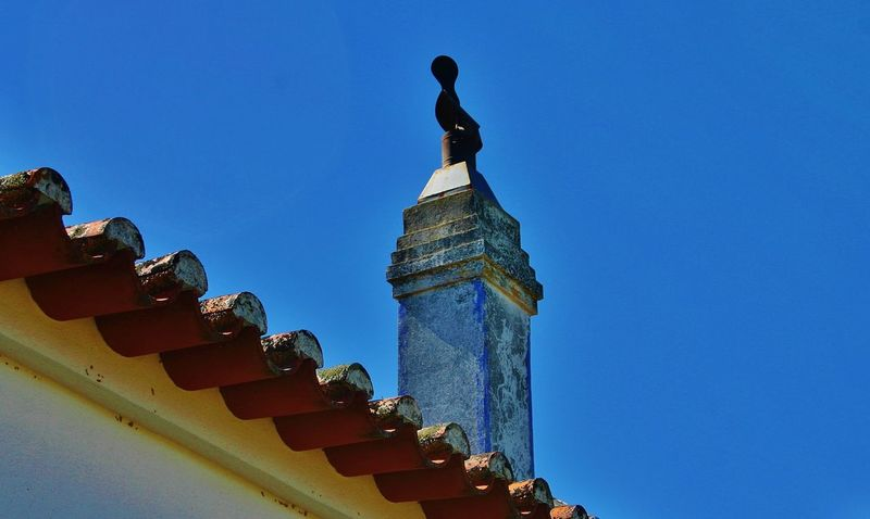 Hot Days Hot Day Outside Chimney Blue Sky Terracotta Roofs Terracotta Rooftiles Beautiful Day Old Buildings Portugal Is Beautiful Tranquility Light And Shadow Rooftop Roof Roof Tile Roofs Chimneys Chimney Top Chimney Tops Shadows Hot Day Portugal Portuguese Village Tiled Roof  Tranquil Scene Portuguese House