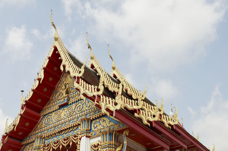 Low angle view of buddhist temple against cloudy sky