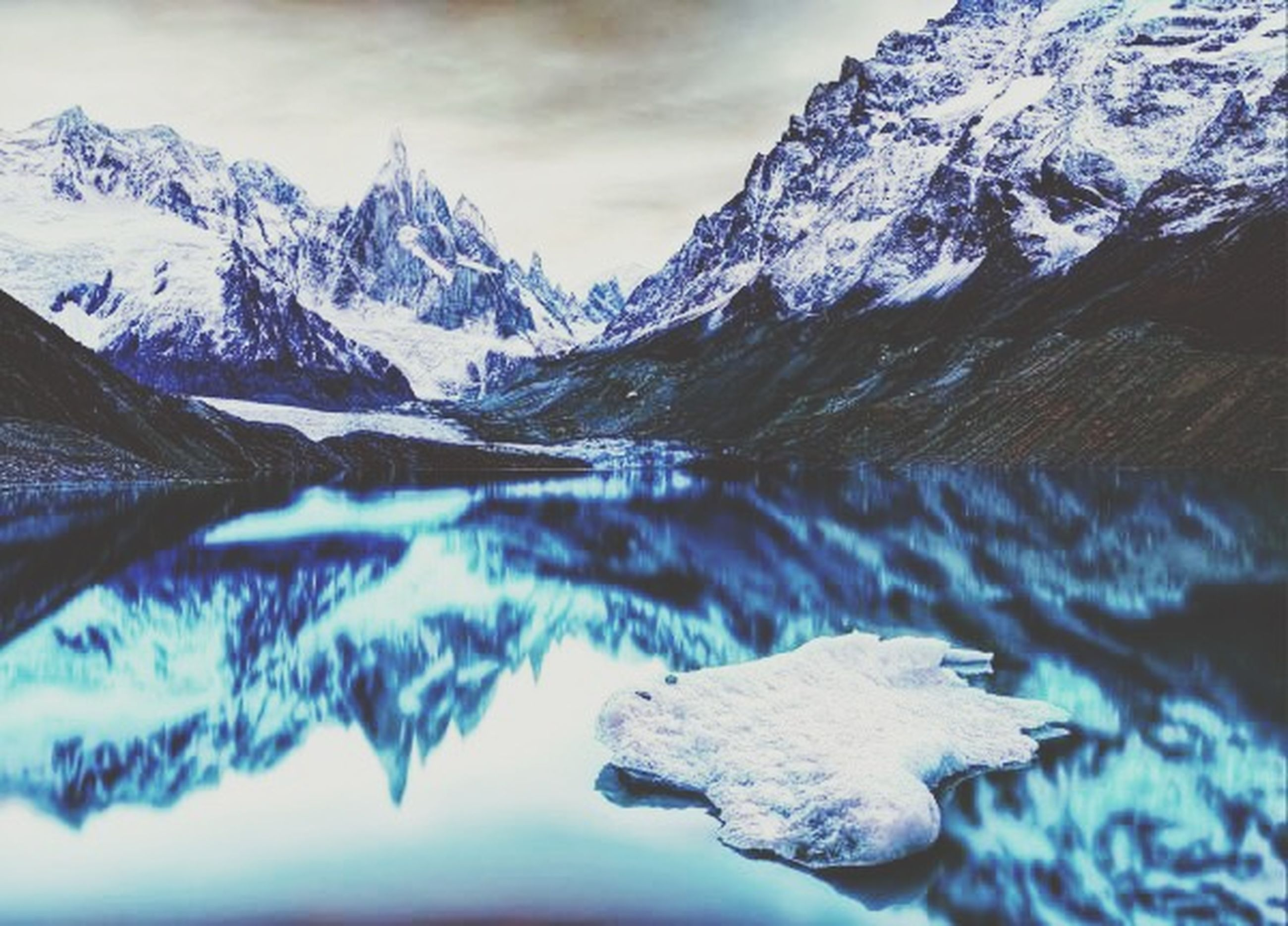 snow, winter, cold temperature, mountain, water, tranquil scene, tranquility, lake, scenics, season, beauty in nature, mountain range, snowcapped mountain, nature, reflection, frozen, weather, waterfront, sky, ice