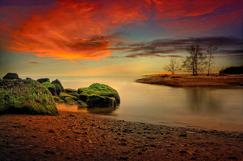 Sunset at Tanjung beach Sky Cloud - Sky Water Tree Beauty In Nature Scenics - Nature Tranquility Tranquil Scene Sunset Land Plant Nature No People Beach Idyllic Sea Non-urban Scene Orange Color Rock Outdoors Rock Trees Slow Shutter