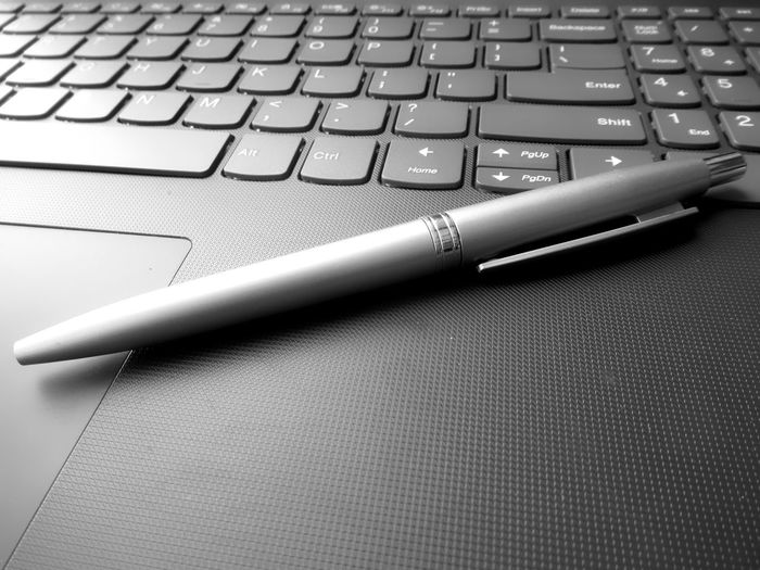 Close-up of pen on laptop