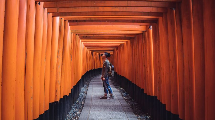 Japan nostalgia Traveling Home For The Holidays The Way Forward In A Row Orange Color Architectural Column Built Structure One Person Cultures Lifestyle Japan Pattern Abstract Portrait Miles Away Break The Mold