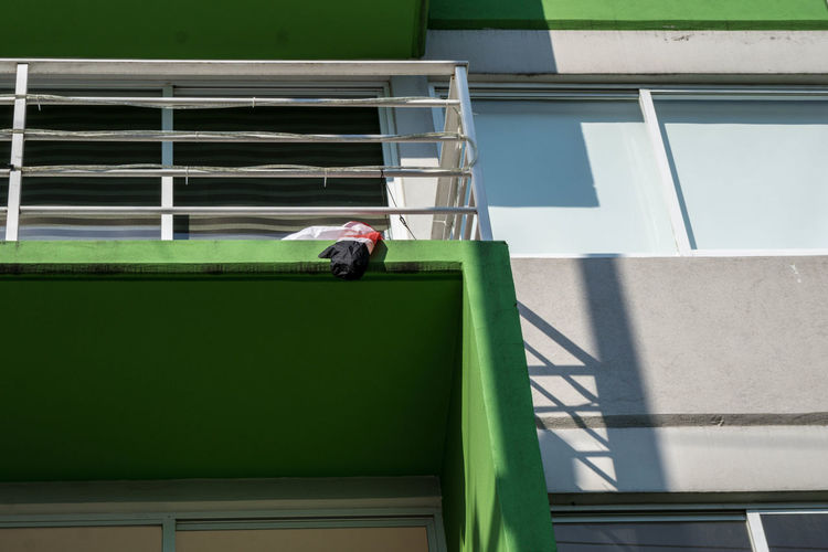 Man working in front of building