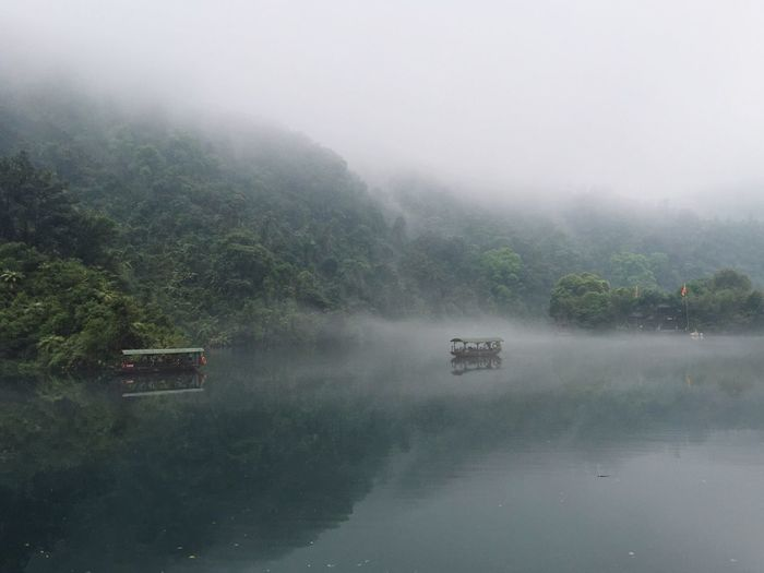 High angle view of lake against sky during foggy weather