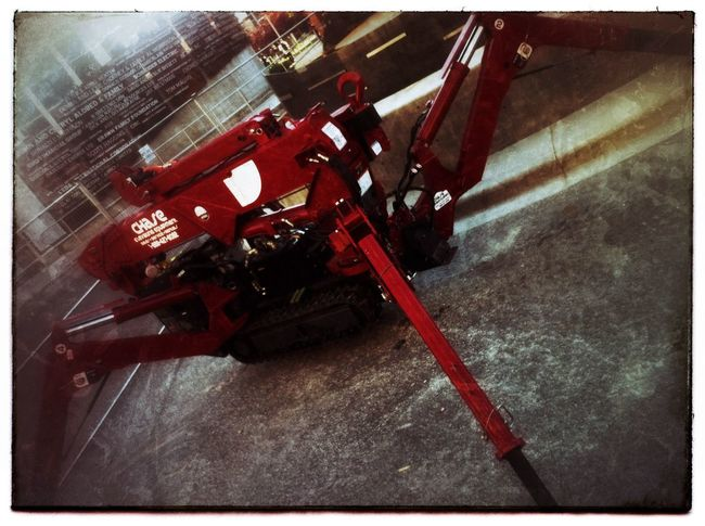 Big red mechanical spider. IPhone Photography Heavy Equipment Photo Of The Day