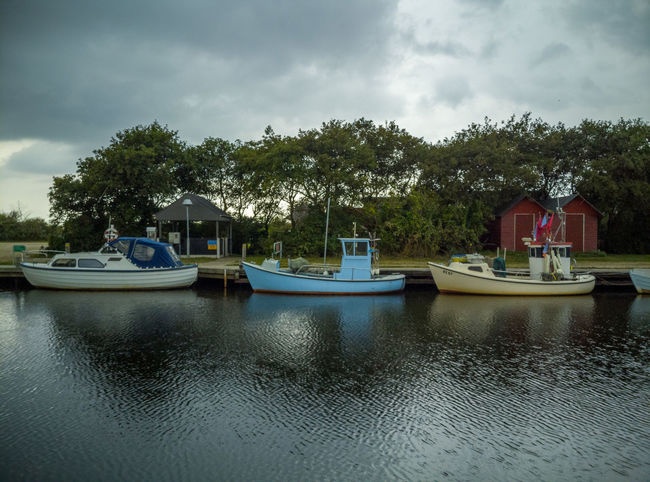 Anchored Architecture Built Structure Cloud - Sky Day Mode Of Transportation Moored Nature Nautical Vessel No People Outdoors Overcast Plant Reflection Sky Transportation Tree Water Waterfront