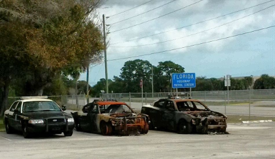 It's so hot in the Florida Sun , the police cars spontaneously combust in the heat