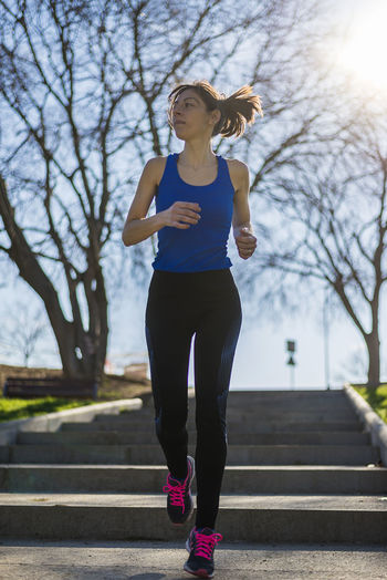 Full length of young woman running
