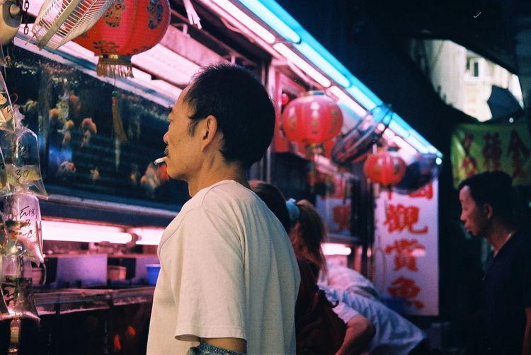 City Life Film Is Not Dead Film Photography Film Photography, Hong Kong Illuminated Market People, Portraits Story The Portraitist - 2016 EyeEm Awards The Journalist Eyem 2016 Awards