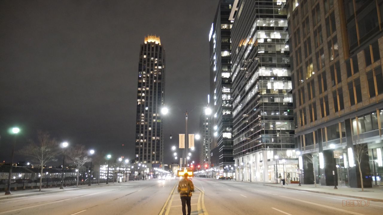 night, illuminated, street light, the way forward, road, architecture, building exterior, transportation, built structure, city, street, outdoors, skyscraper, sky, one person