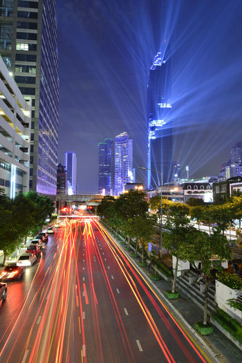 "Light show of new tallest building name is ""Mahanakorn"" in Bangkok, Thailand. Architecture Bangkok, Thailand. Building Exterior Business City City Life City Street Connection Illuminated Light Trail Long Exposure Modern Motion Night Outdoors Road Sky Skyscraper Street Street Light Traffic Transportation Travel Destinations Urban Skyline"