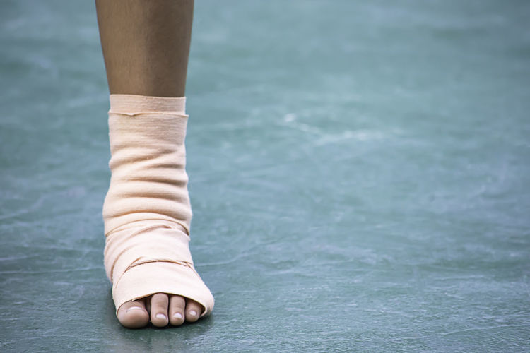 Low section of person with bandage