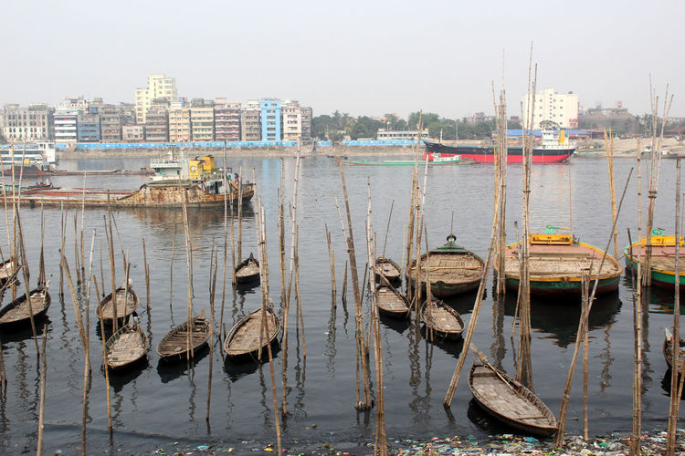 Water Nautical Vessel Transportation Mode Of Transportation Architecture Building Exterior Nature Built Structure Day Moored Reflection City Outdoors Sailboat Harbor Wooden Post Port River Waterfront Urban Landscape City Landscape
