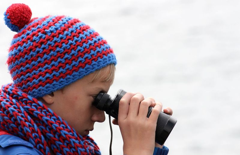 searching for interesting things One Person Child Headshot Clothing Childhood Warm Clothing Winter Knit Hat Holding Portrait Men Males  Hat Day Looking Real People Technology Cold Temperature Outdoors Innocence Field Glasses Boy Spy