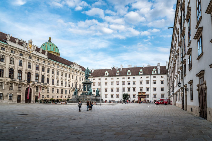 Courtyard in Hofburg Palace of Vienna Hofburg Hofburg Palace Imperial Tourist Attraction  Travel Travel Travel Destinations Architecture Building Exterior Built Structure Capital Cities  City Cloud - Sky Courtyard  Day Landmark Outdoors Real People Royal Palace Sky Travel Destinations