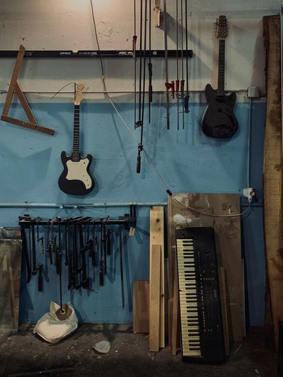 Things Organized Neatly Things Arranged Neatly Guitar Keyboard Hanging Indoors  No People Music Musical Instrument Choice Musical Equipment Guitar Workshop String Instrument Wall - Building Feature Arts Culture And Entertainment Large Group Of Objects Equipment
