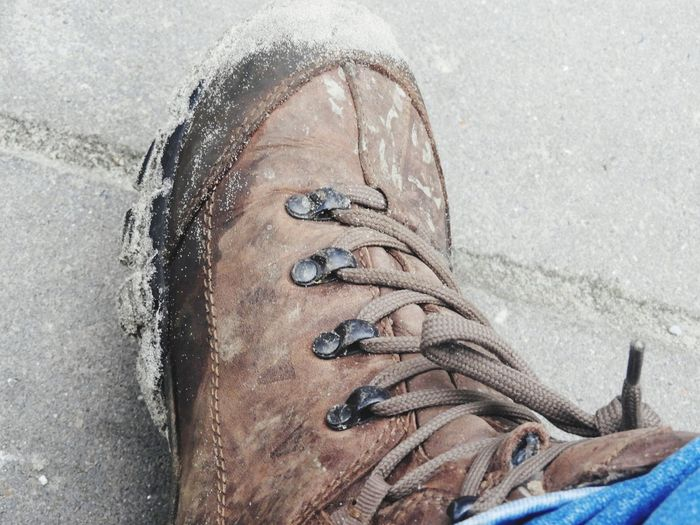 Walking Boot Shoe Lifestyles Real People One Person Day Leisure Activity Outdoors Close-up Adults Only Winter Low Section Water People Adult Human Body Part Finding New Frontiers