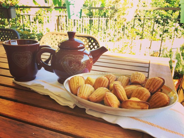 Breakfast with Madeleines Tea Teatime Table Food And Drink Food No People Freshness Plate Day Healthy Eating Sweet Food Outdoors Tranquility Healthy Lifestyle Bakery Home Made Food And Drink Freshness Close-up Ready-to-eat Sunny