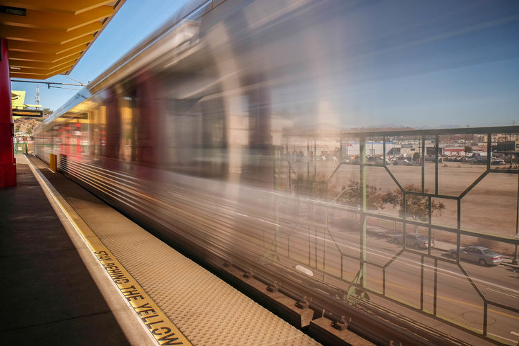 Blurred motion on train at railroad station platform