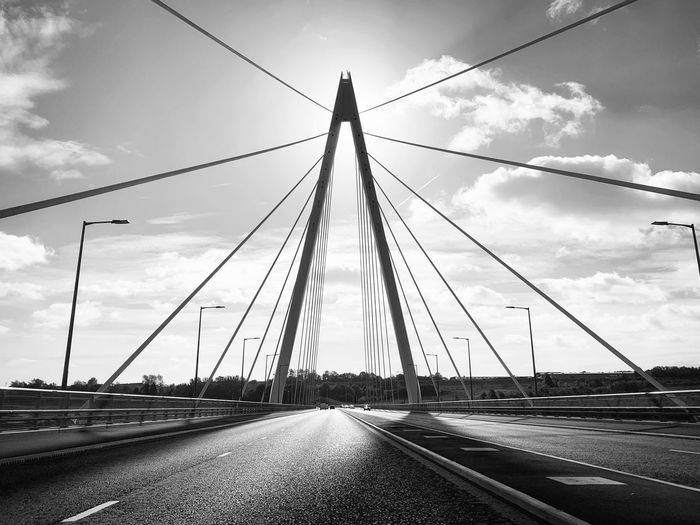 Northern Spire - Sunderland ShotOnIphone Mono Shotoniphonexsmax IPhoneography Perspectives EyeEm Masterclass Mobilephotography Sky Transportation Cloud - Sky Connection Bridge Cable The Way Forward Bridge - Man Made Structure Built Structure Nature Architecture Diminishing Perspective Suspension Bridge Surface Level Cable-stayed Bridge Outdoors No People Road Direction
