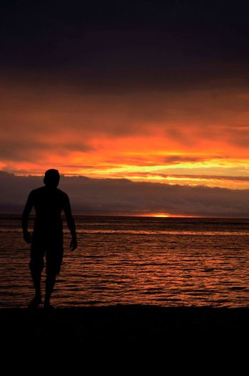 Call of the sea. Sunset One Person Lake Sky Silhouette One Man Only Full Length Outdoors Cloud - Sky Beauty In Nature Sea And Sky Seascape Island Islandlife Sunset Silhouettes