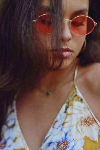 Close-Up Of Teenage Girl Wearing Sunglasses